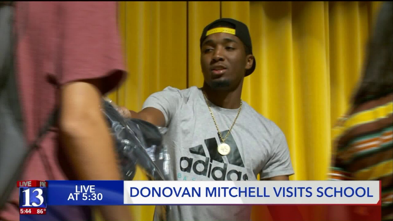 Donovan Mitchell surprises Kearns High students with backpacks, t-shirts