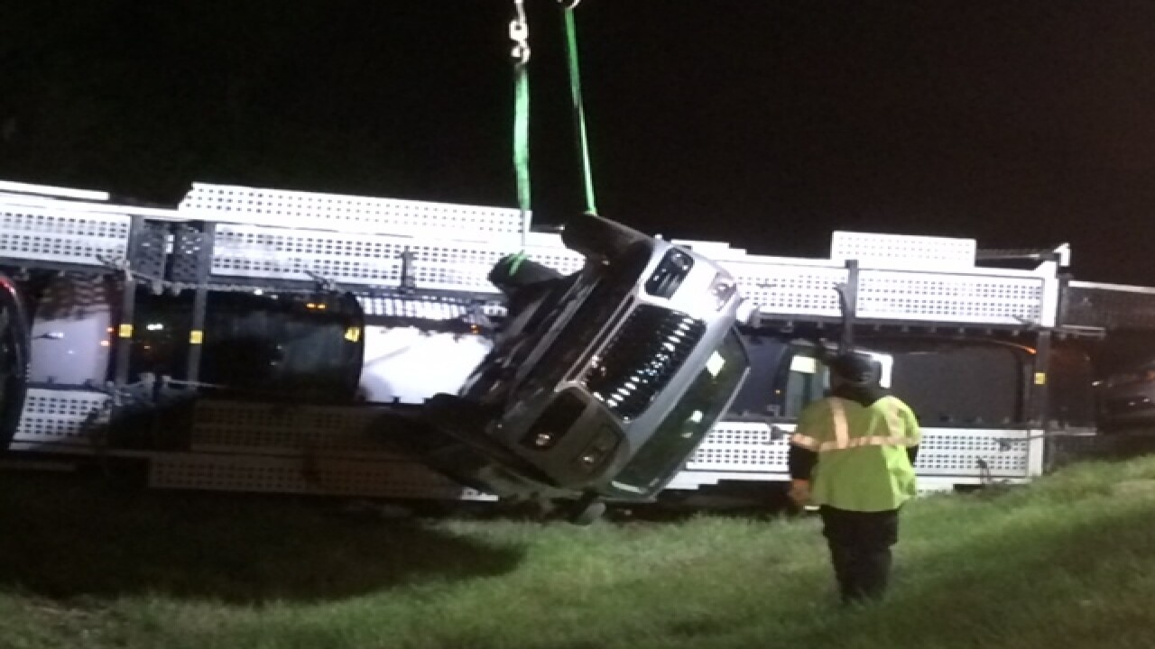 PICS: Rig carrying Audis overturns in embankment