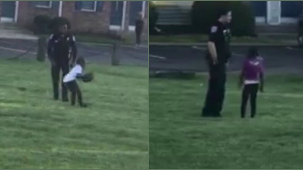 Officers play football with kids in Richmond