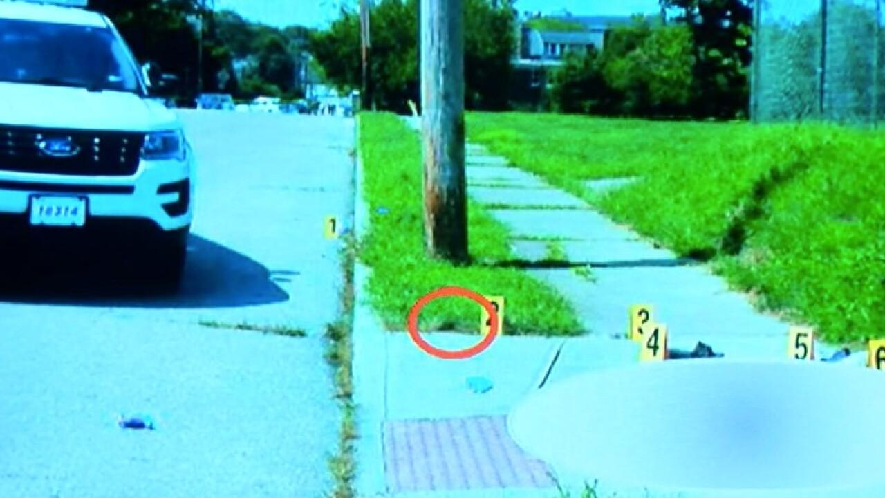 Vernell_Jackson_shooting_Car_gun_evidence_marker.jpg