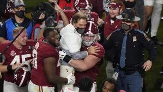 Alabama Crimson Tide coach Nick Saban celebrates with players after winning 2021 College Football Playoff National Championship