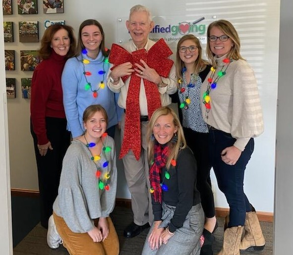 Roger_Grein_with_Magnified_Giving_team_holiday_cropped.jpg
