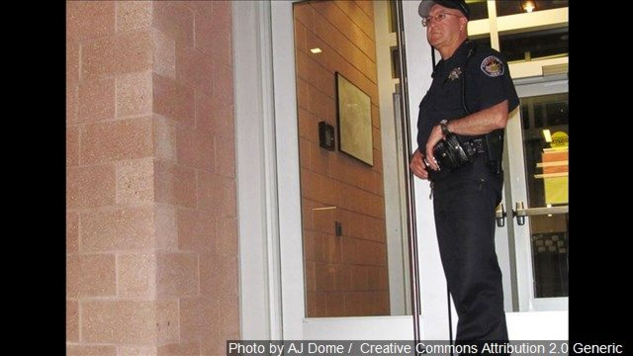 An unidentified sheriff's deputy guards the