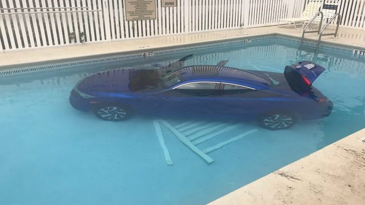 Car rolls into pool with father, daughter inside