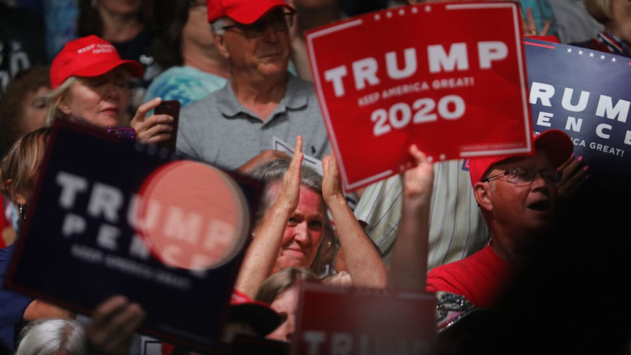 North Carolina cheerleading team placed on probation after posing in front of 'Trump 2020' sign