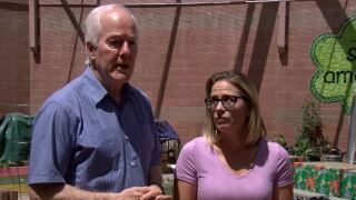 Sen. John Cornyn (R-Texas) and Sen. Kyrsten Sinema (D-Ariz.) spoke to members of the media on June 1, 2021, after touring a CBP facility that houses migrants and Casa Alitas -- a shelter that helps migrants get on their feet in the U.S. after arriving.