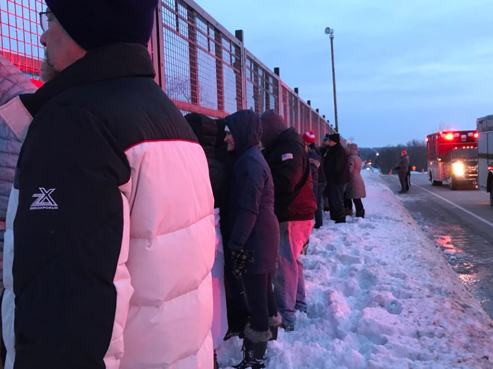 Milwaukeeans line the procession route to pay respects to Officer Matthew Rittner