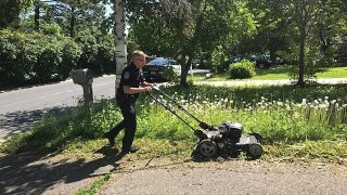 An elderly woman's lawn was overgrown. So this Minnesota police officer mowed it for her