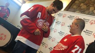 Dylan Larkin surprises Special Olympics athletes in his hometown with shoes, gear