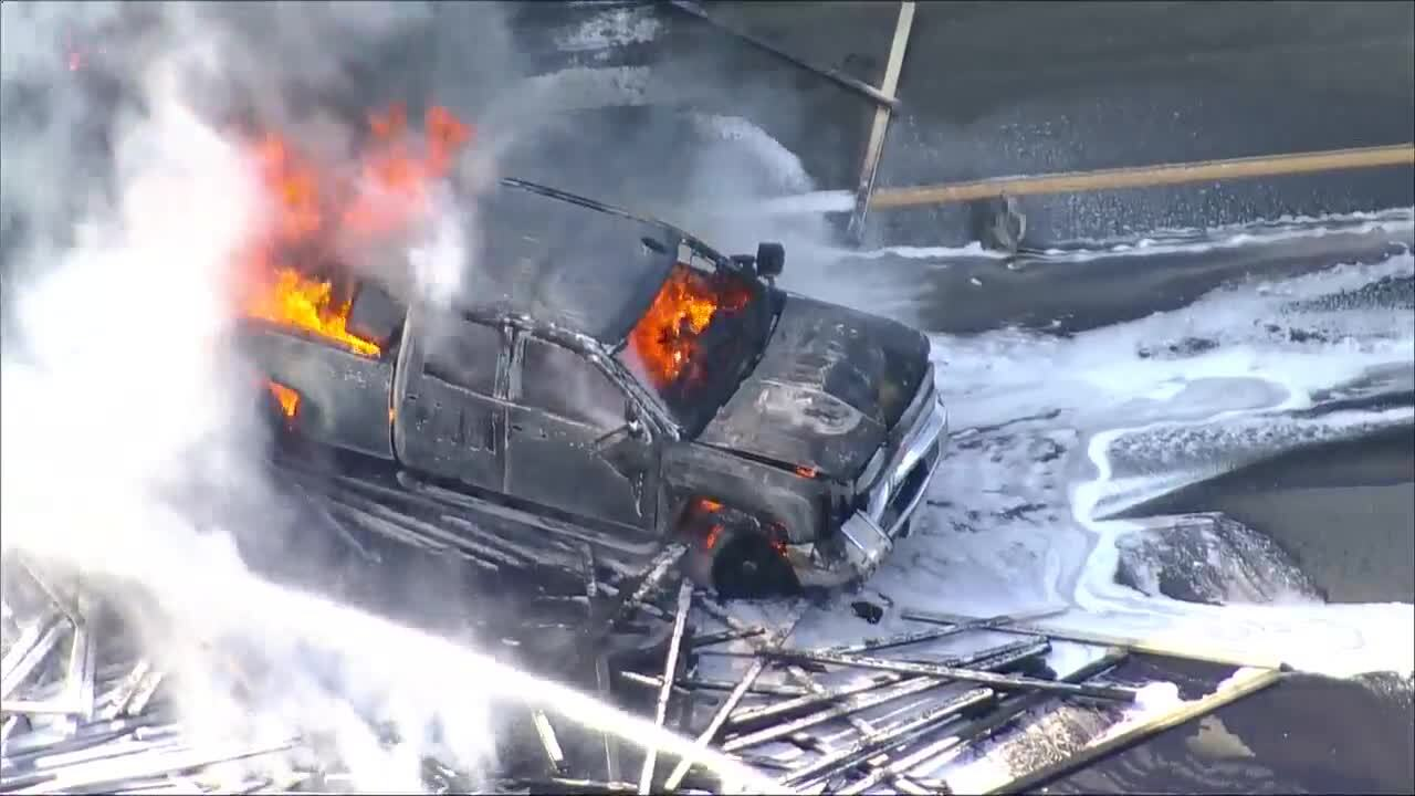 Four dead, semi driver arrested after I-70 fiery crash involving 28