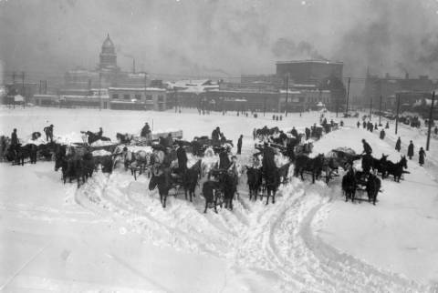 City_Teams_Unloading_Snow_on_Civic_Center.jpg