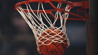 College basketball teams face COVID-related challenges in the upcoming season.