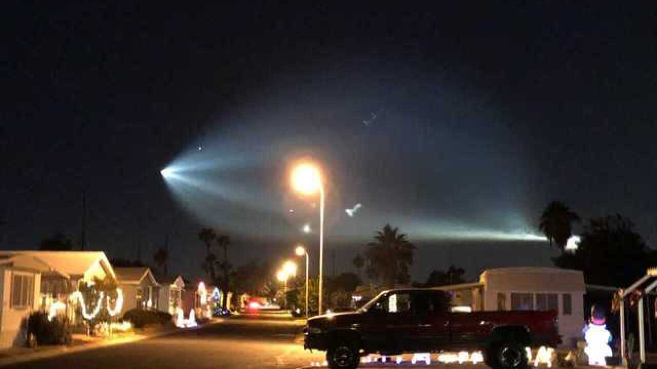 SpaceX rocket launch lights up the night sky
