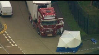 39 people found dead in truck container in Britain