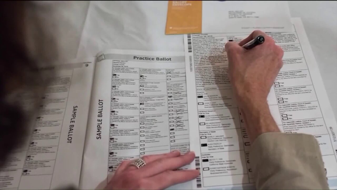 Woman filling out a ballot