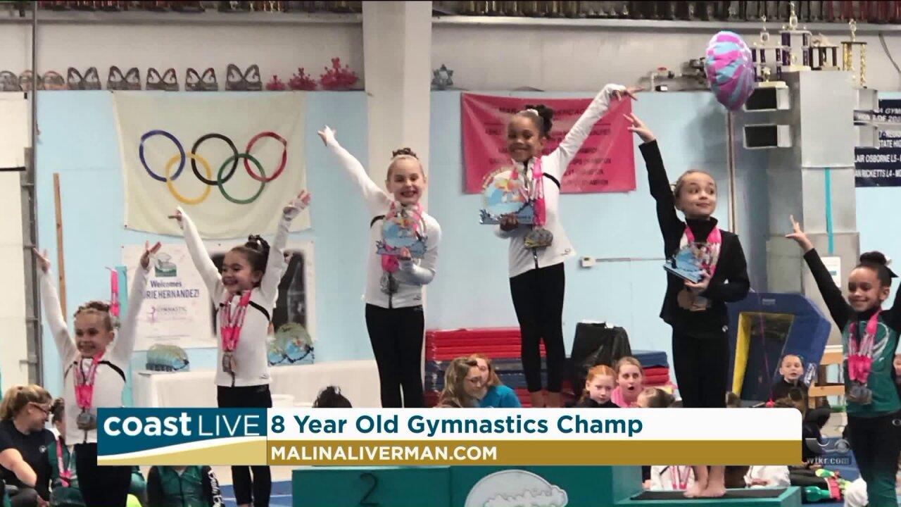 A local gymnast balancing school and athletics on CoastLive