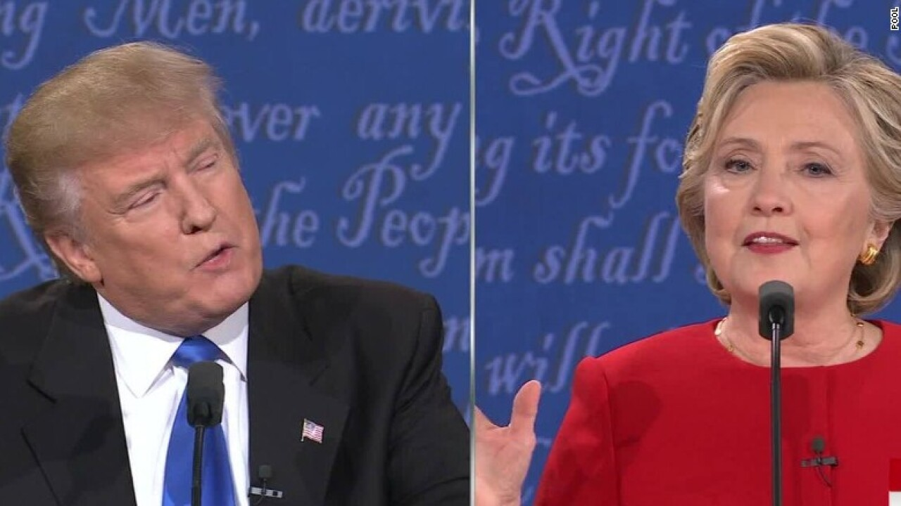 Clinton puts Trump on defense at first debate