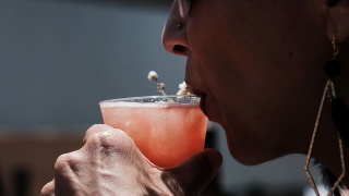 Forcing a smile for customers linked with heavier drinking after work, new study says