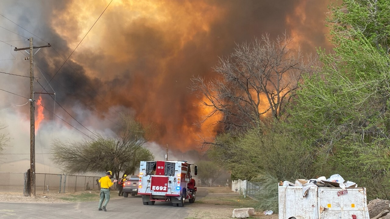 Officials say a small community in south-central Arizona remained under an evacuation notice Friday after crews and air tankers stopped the growth of a wildfire that burned at least 12 homes on Thursday.