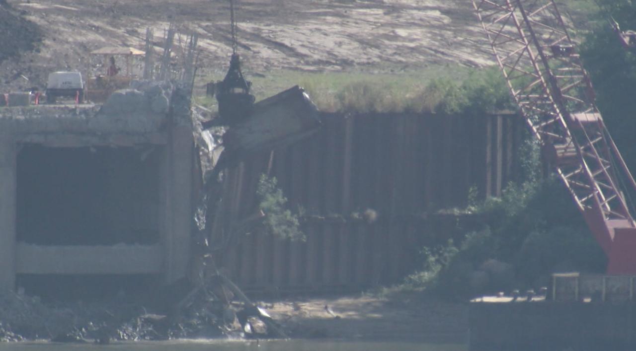 Crews use barge-mounted crane to remove debris at Beckjord on Sept. 17, 2021.