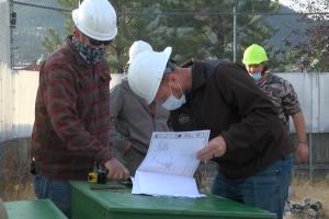 Volunteers at Montana WILD study building plans