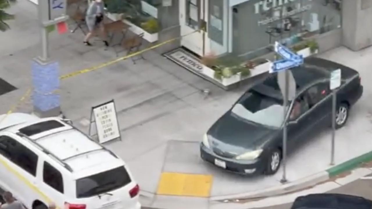 Witness: downtown standoff leads to 'crazy' drive on sidewalk, crowded street