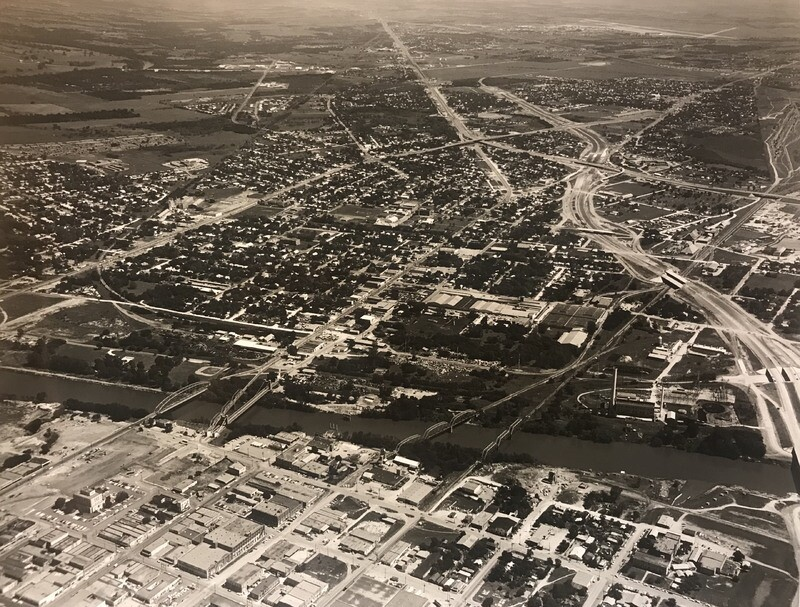 I-35 being built in 1957. The construction would force people to move out of there homes.