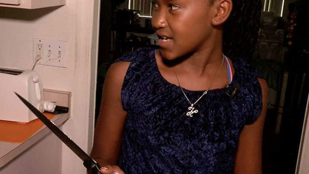 12-year-old scares off burglar with knife
