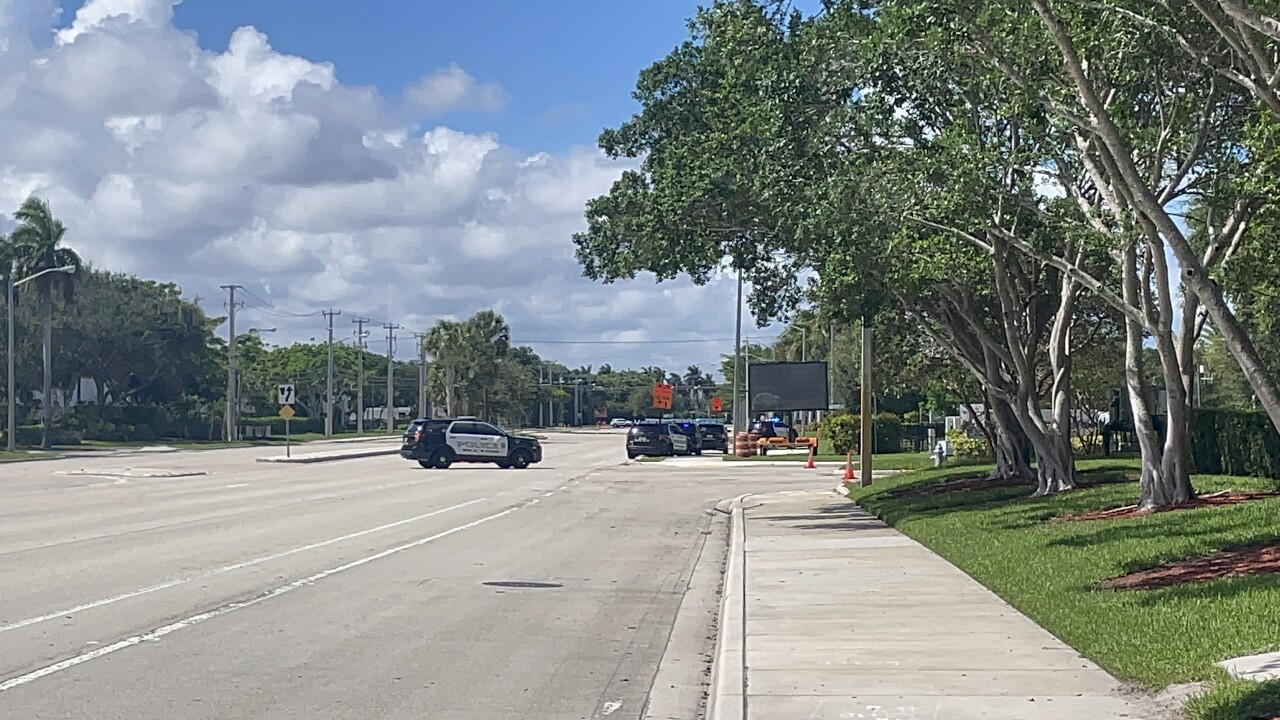 Boca Raton police say an armed man fired several rounds Sunday afternoon from an apartment balcony.