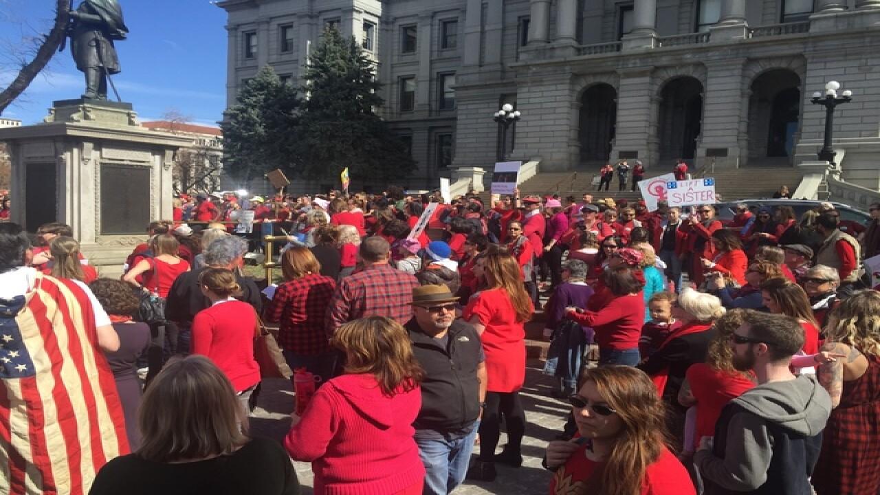 GALLERY: Hundreds of women march on Denver