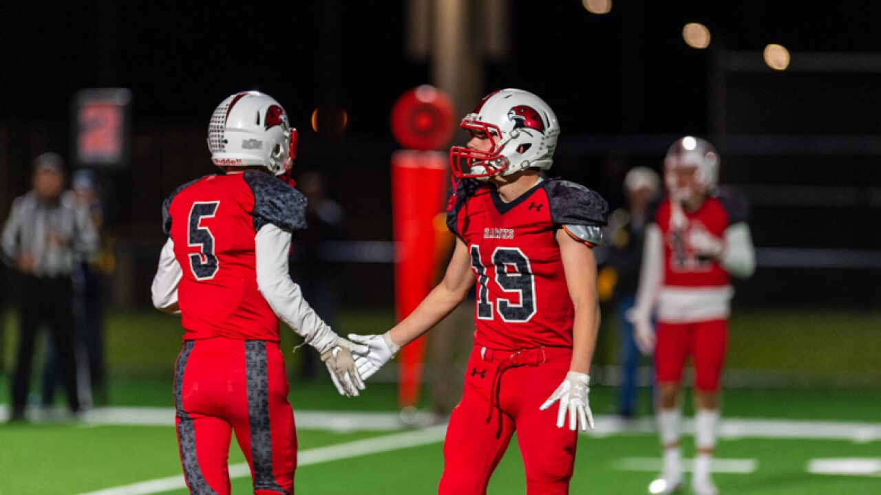 Twin brothers (#5) Brady Lang and (#19) Padraig Lang high-five one another