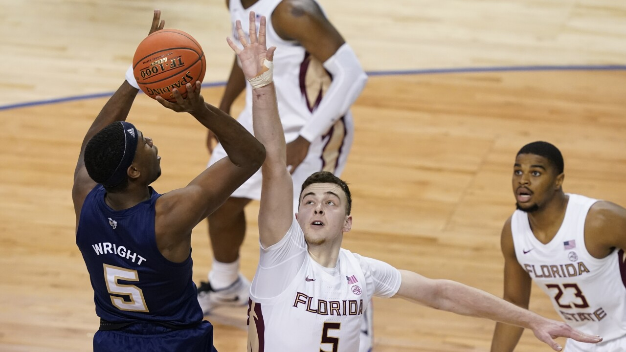 Georgia Tech Yellow Jackets forward Moses Wright shoots over Florida State Seminoles center Balsa Koprivica in 2021 ACC Tournament championship game