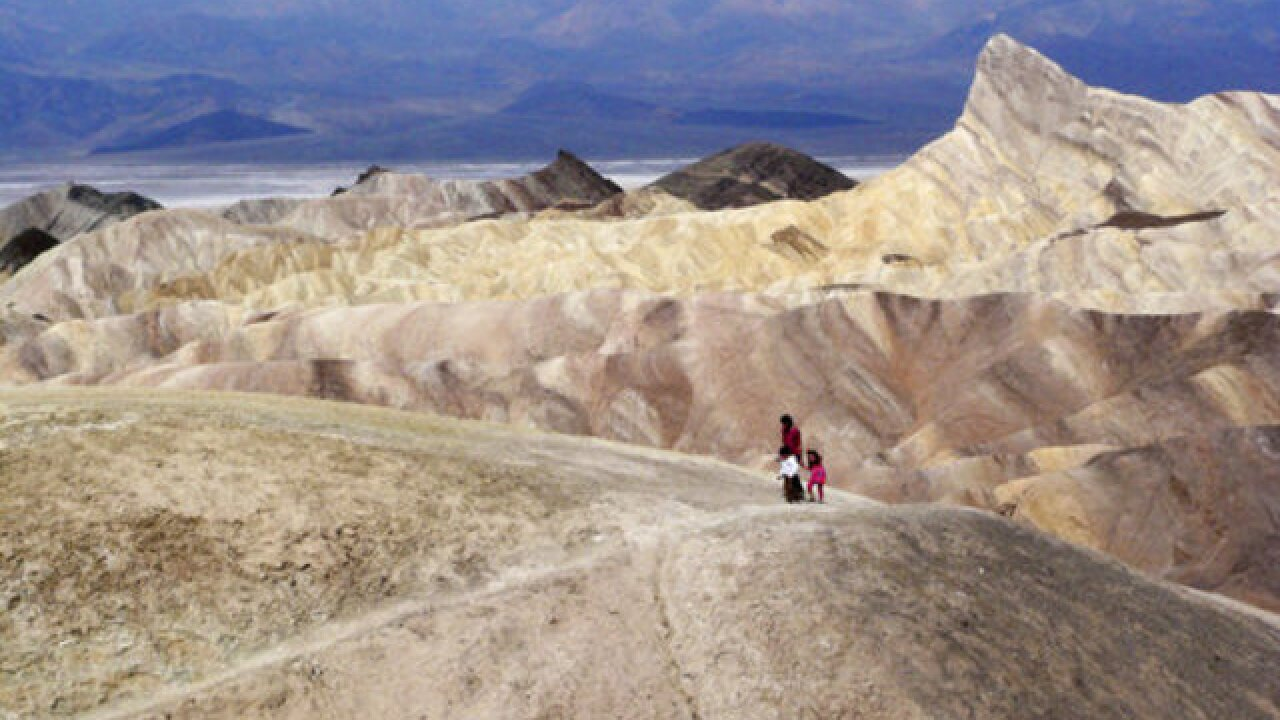 Tourists descend as temperatures climb in Death Valley