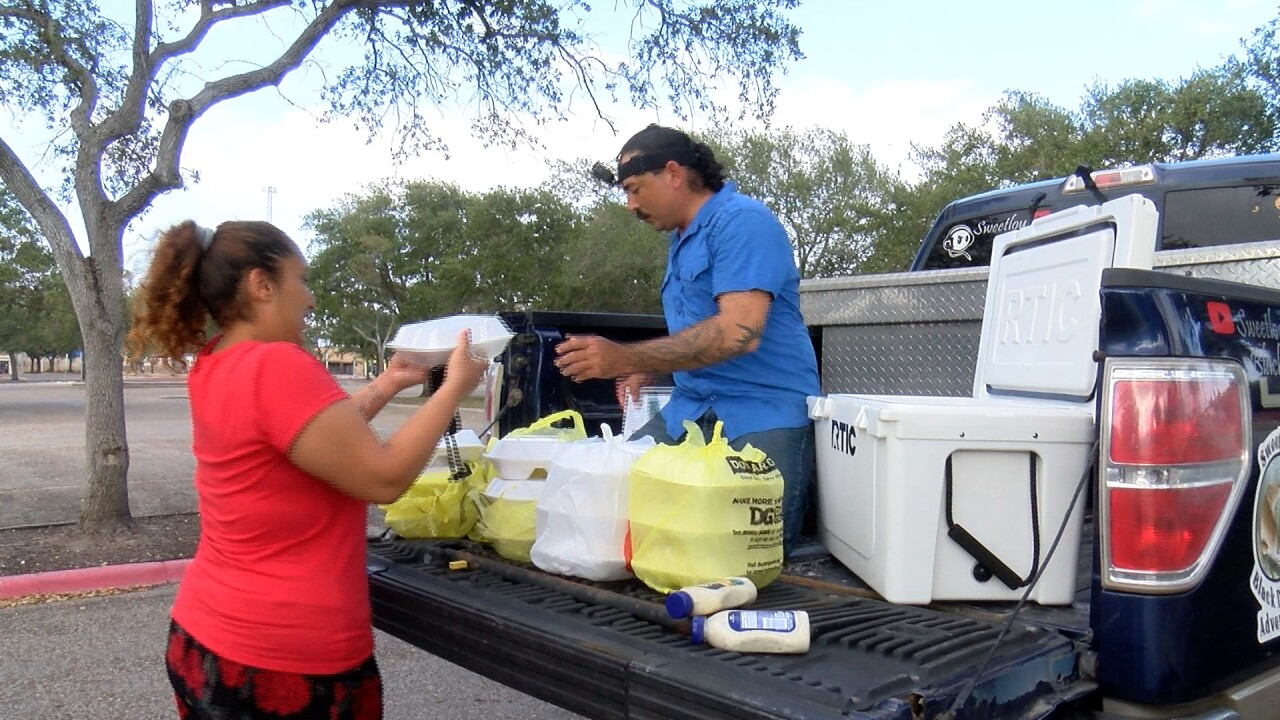 Luis Hernandez fishes, cooks for the needy