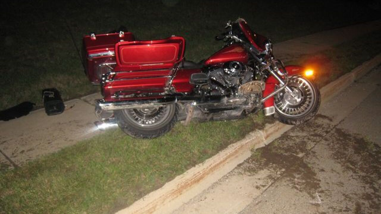 Motorcyclist hits curb, flown to hospital