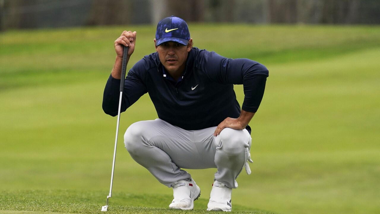 Brooks Koepka lines up putt at 2020 PGA Championship