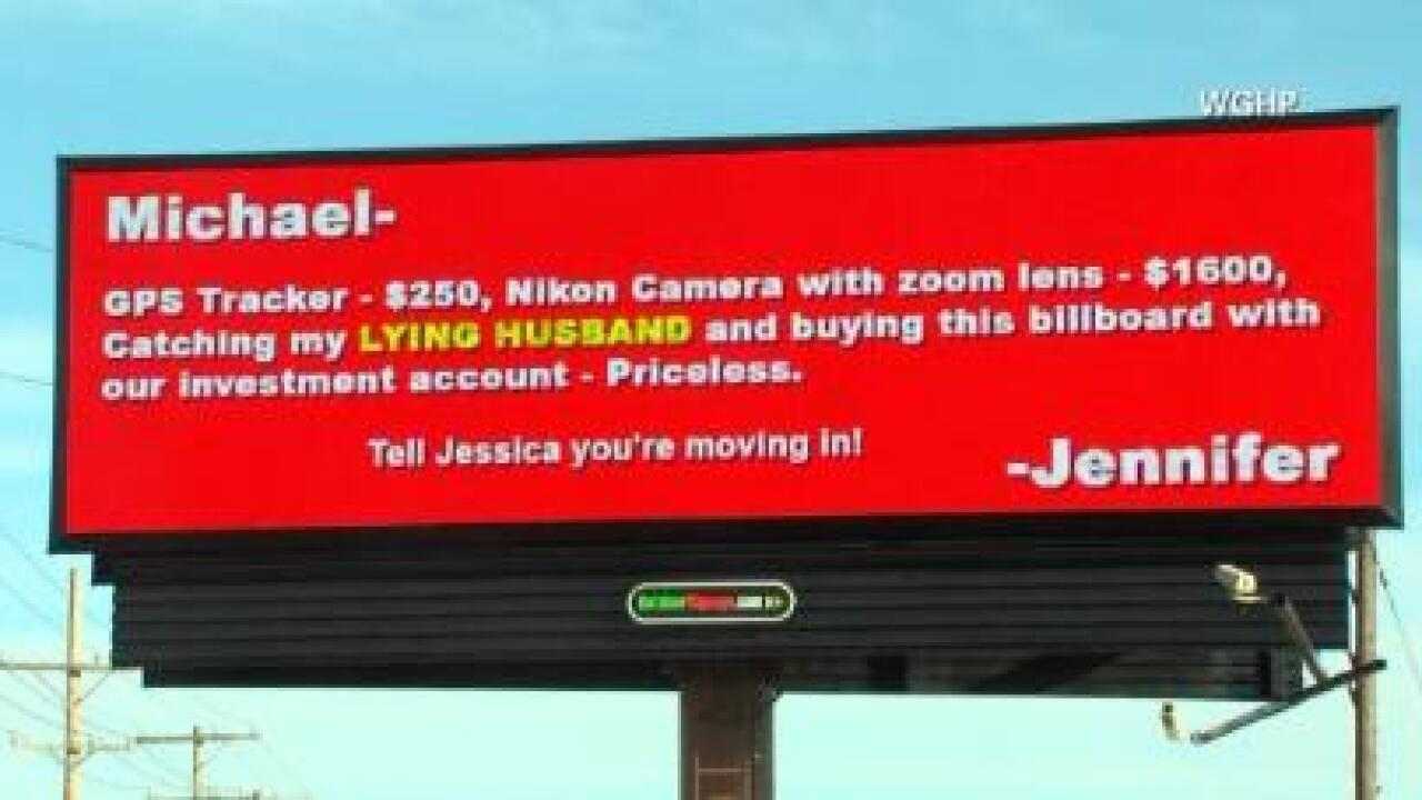 Cheating husband busted on billboard