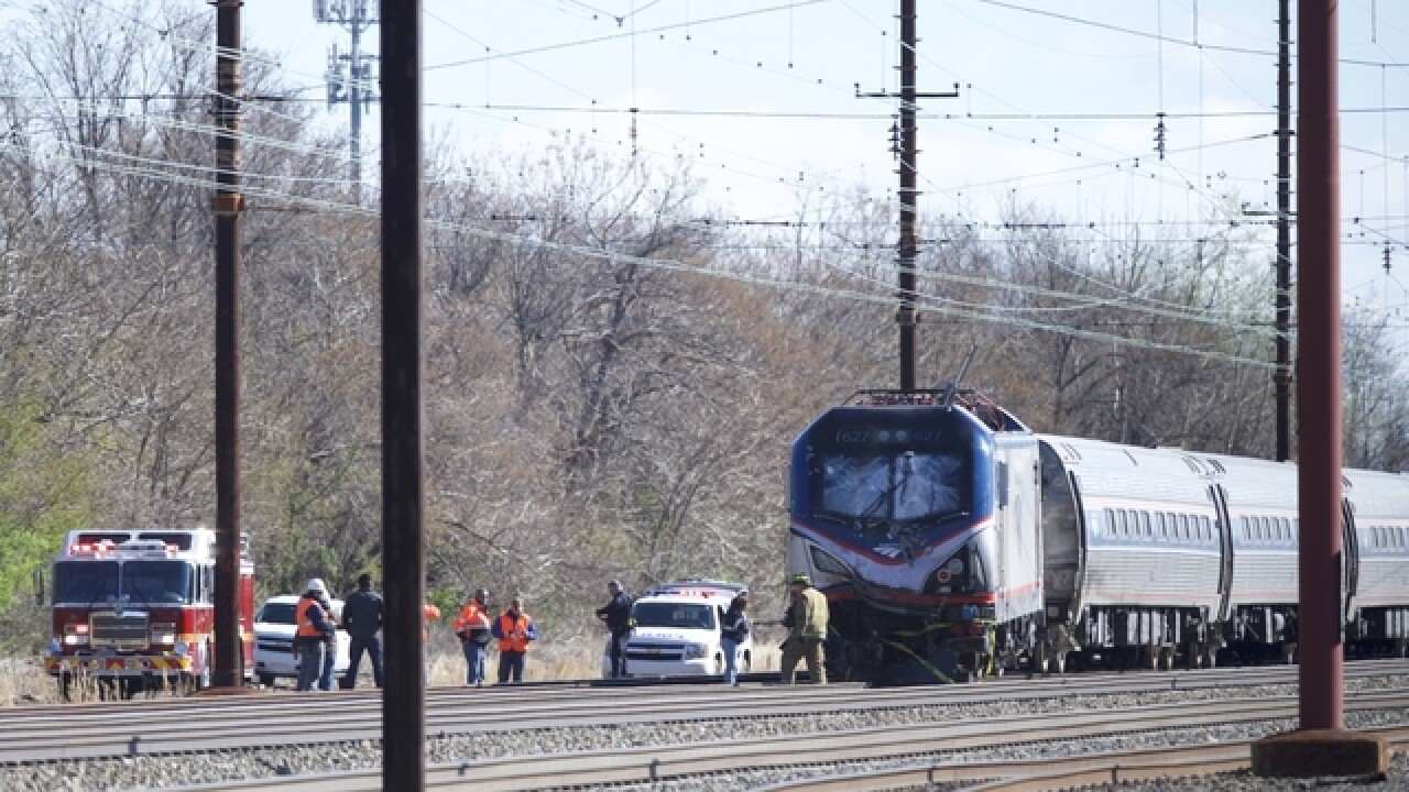 Amtrak train slams into pickup, killing 3 men