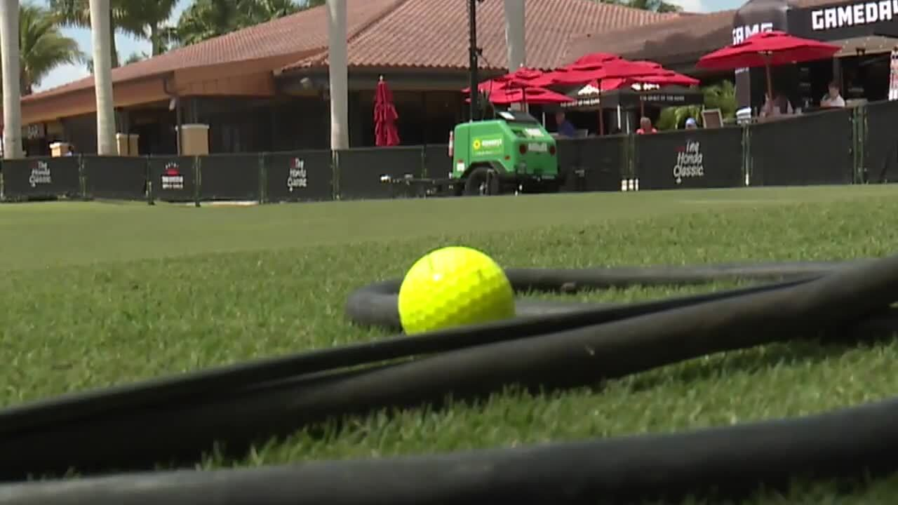 yellow golf ball on grass at 2021 Honda Classic