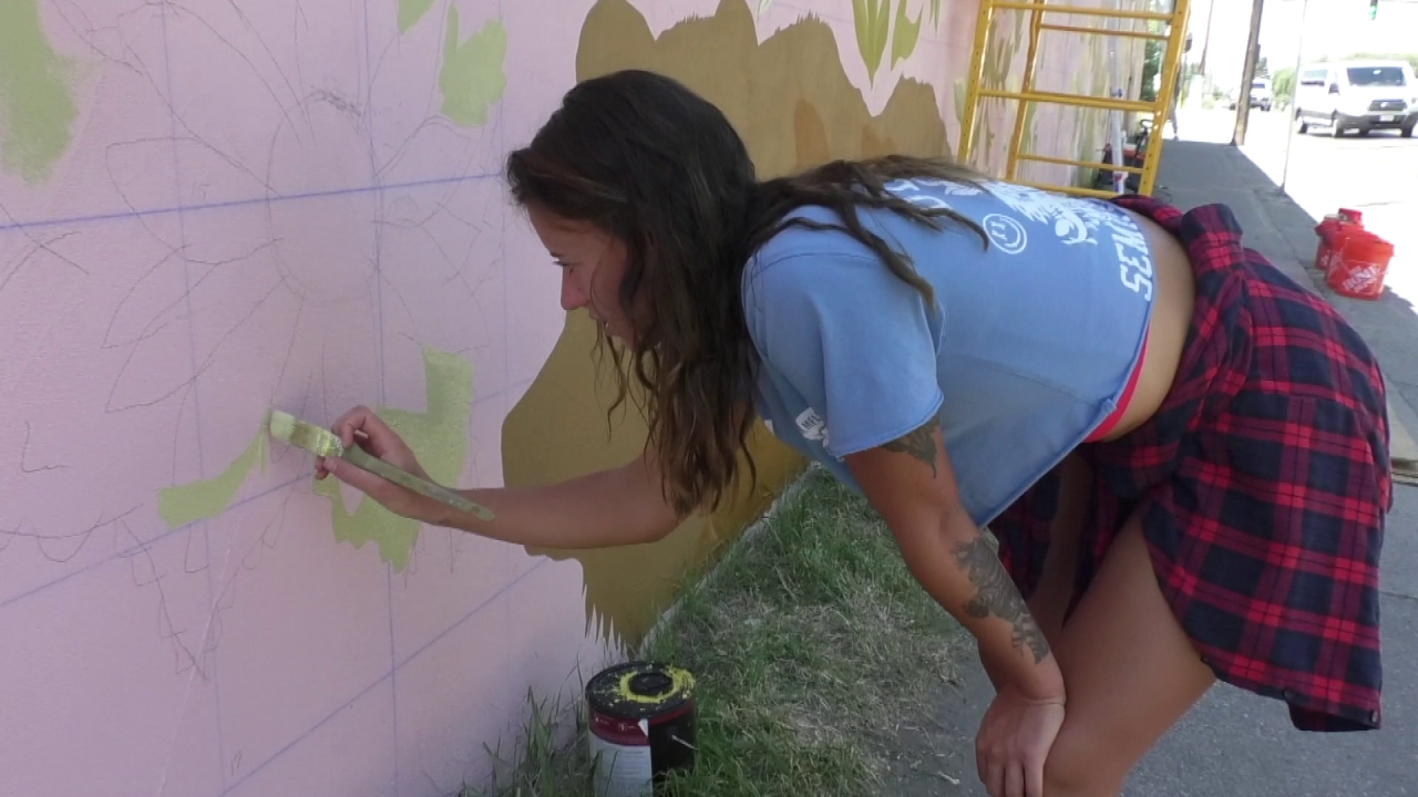 Gabrielle Lewis at work on the mural