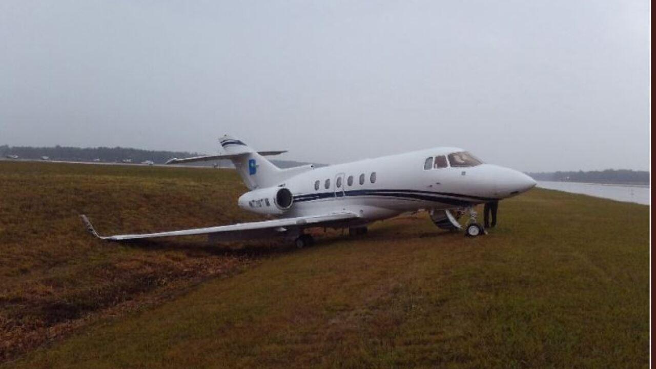 Small plane slides off runway at Richmond InternationalAirport