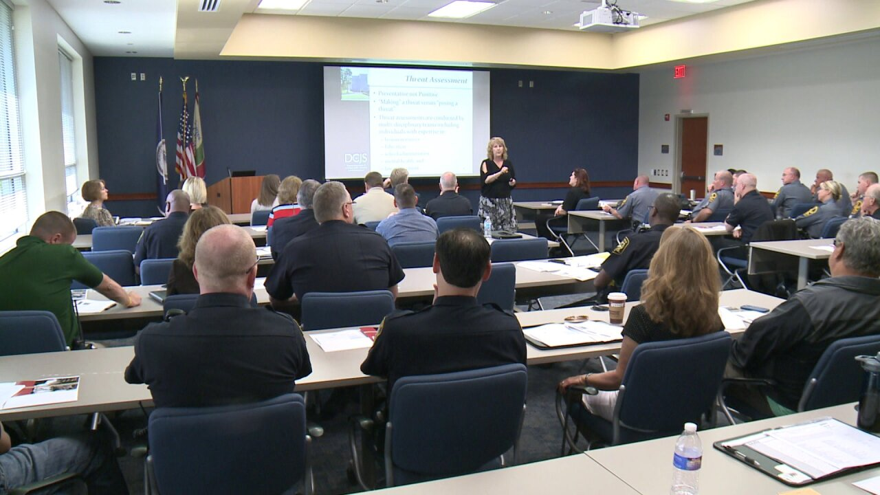Local law enforcement officers pack meeting on school safety