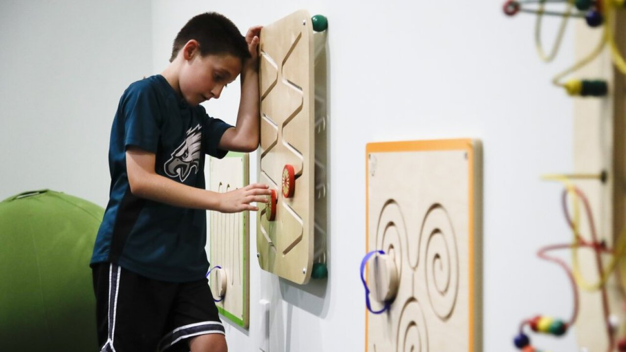 In this Thursday, Aug. 22, 2019, photo, 10-year-old Jack Ykoruk plays in the Lincoln Financial Field sensory room before a preseason NFL football game between the Philadelphia Eagles and the Baltimore Ravens in Philadelphia. (AP Photo/Matt Rourke)
