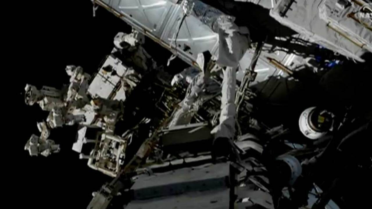 A live look at two astronauts (NASA's Anne McClain & Canda's David Saint-Jacques) set up a redundant power source for the International Space Station's Canadarm2 robotic arm on April 8, 2019.