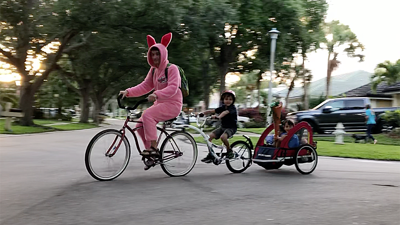 He lost his wife to cancer. So he bikes with his kids to school dressed in a bunny costume to make people smile