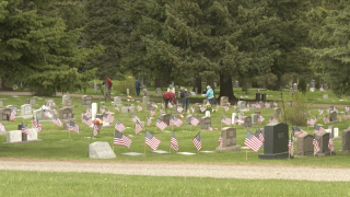 American Legion places over 2,500 flags on veteran's graves at Sunset Hills Cemetery