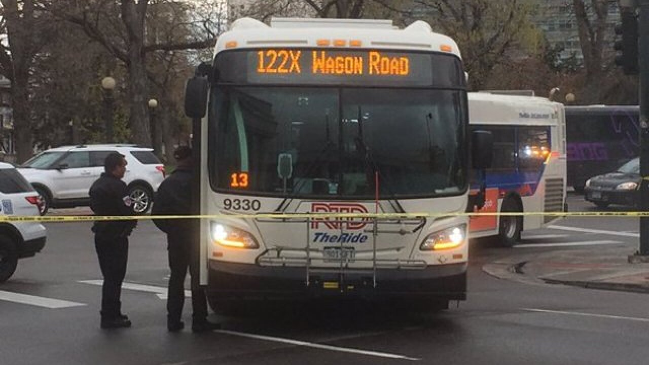 Woman hit by RTD bus at 14th and Broadway