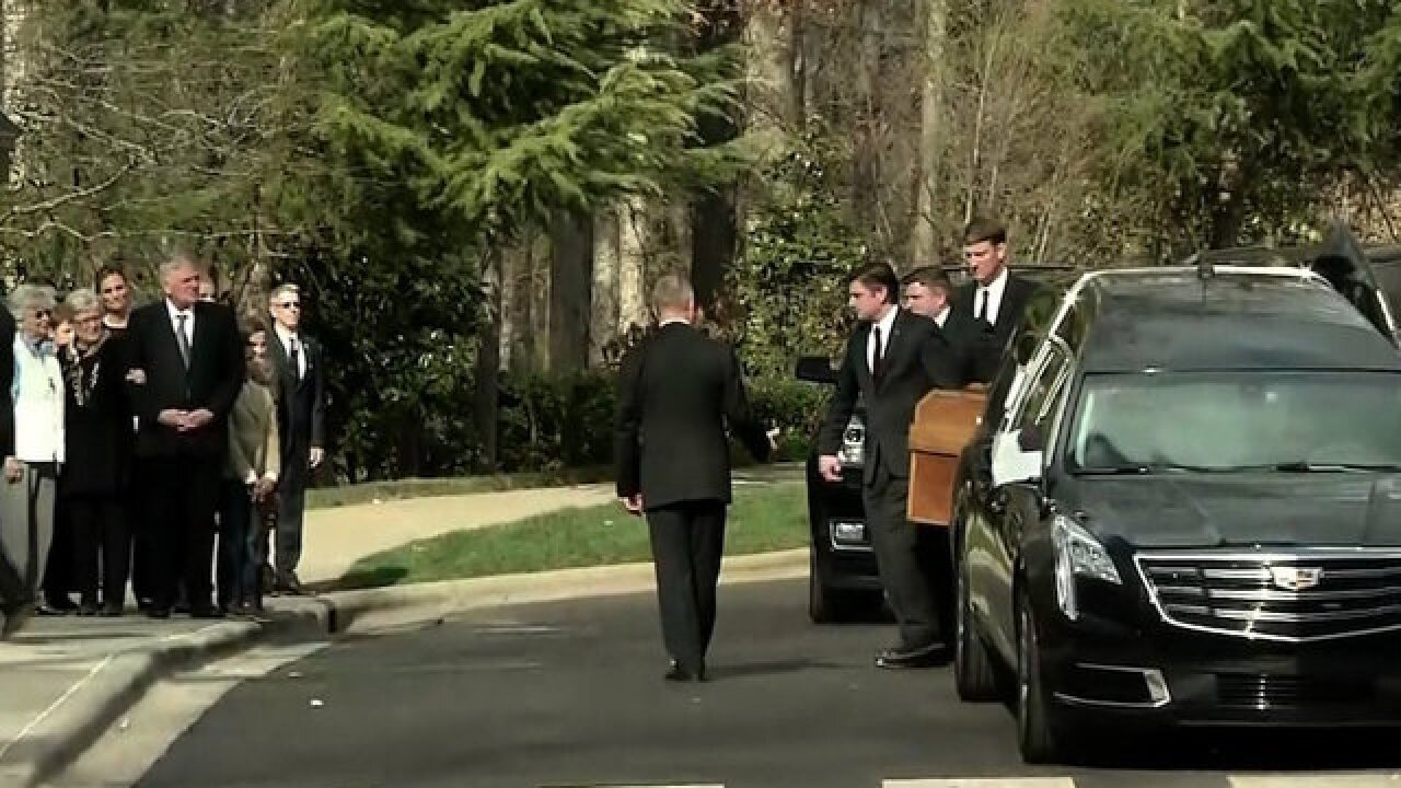 Crowds line up to see Billy Graham's funeral motorcade bring his casket from Asheville to Charlotte