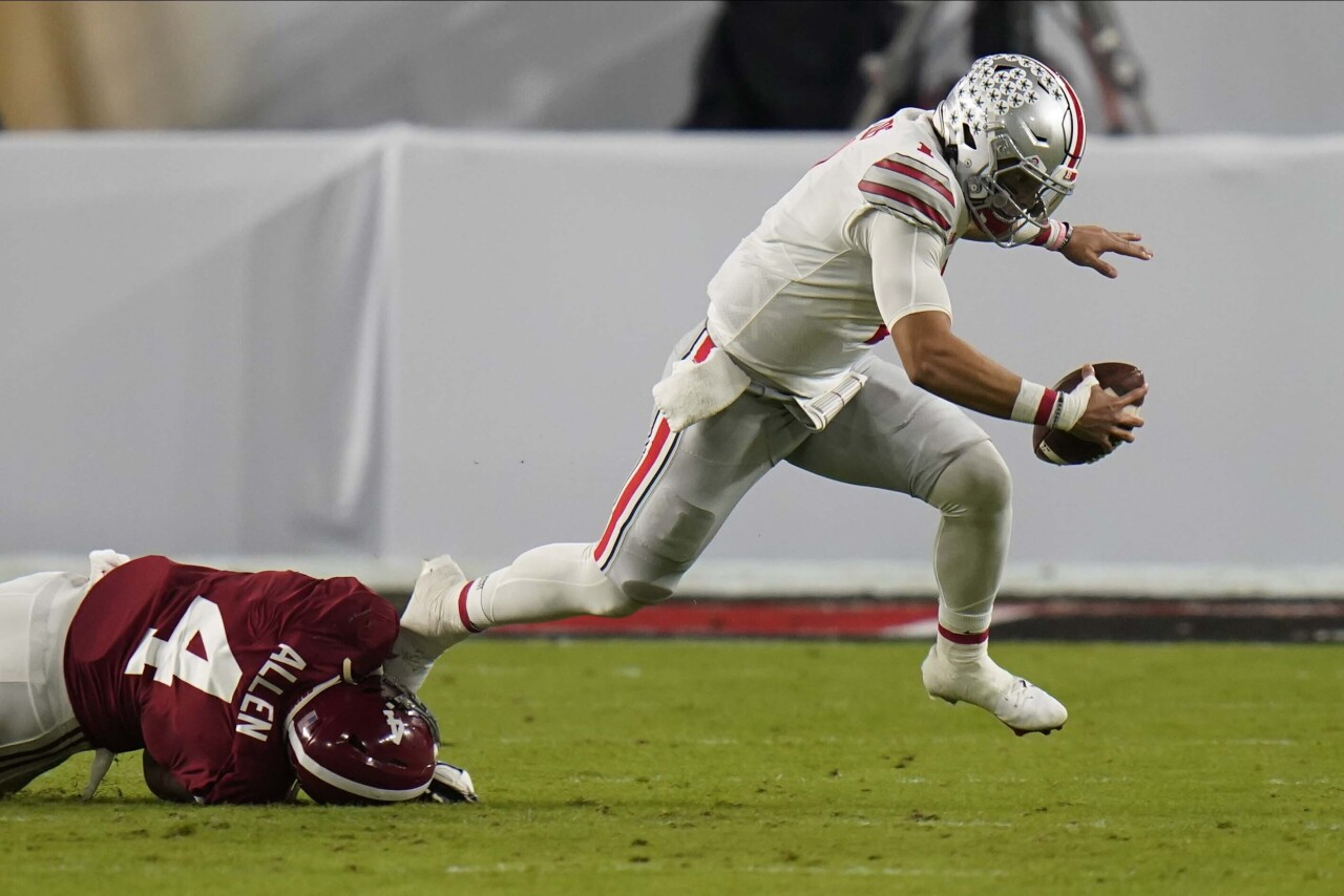 Ohio State Buckeyes QB Justin Fields tackled by Alabama Crimson Tide linebacker Christopher Allen in first quarter of 2021 College Football Playoff National Championship
