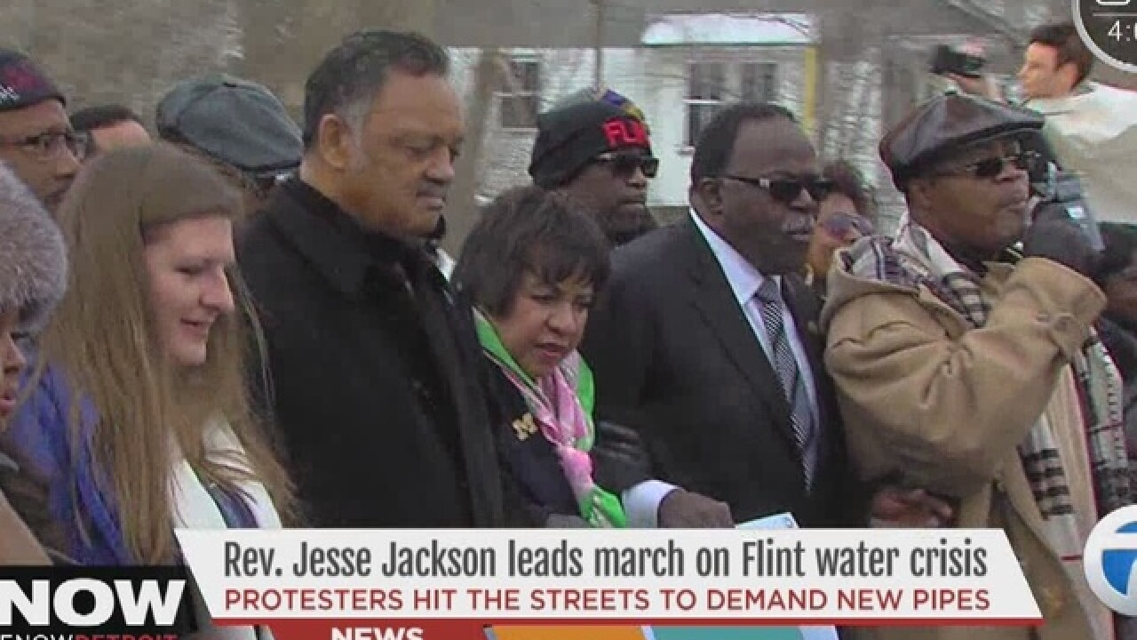 Rev. Jesse Jackson leads march through Flint